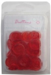 Red colored transparent plastic buttons collection